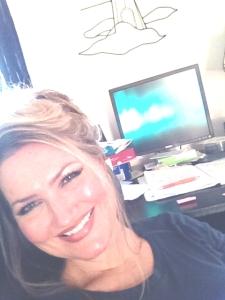 M_ Leighton at desk